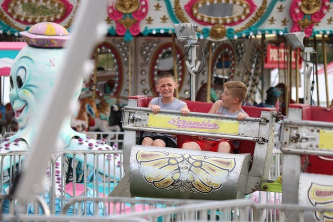 Two boys take a spin on the Scrambler ride at the 37th annual Walleye Festival in 2017. The popular festival is set to return to Waterworks Park for its 40th year this Memorial Day weekend after having been canceled in 2020.