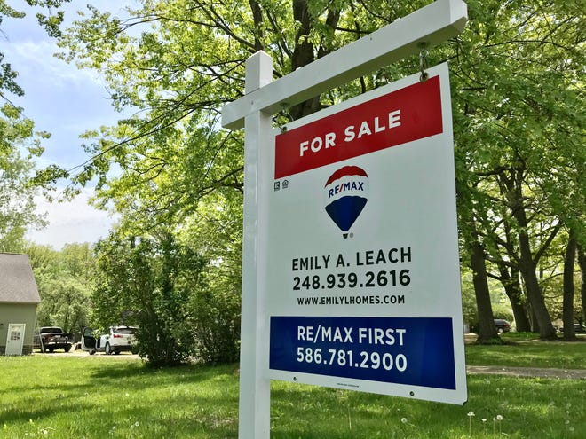 A RE/MAX First for sale sign in Chesterfield Township on May 20, 2021.