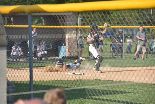 Kenzi Boyd slides in to score the tying run. Chambersburg defeated Bishop McDevitt 5-3 on Thursday, May 20 at Big Spring High School, winning the 2021 Mid-Penn softball title.