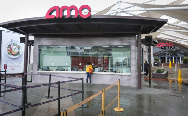 Howard Lipin AMC Theatres at the Westfield Mission Valley shopping center in San Diego is seen in March 2020. Movie studios are releasing new films into theaters again, and cinemas are working to draw audiences back.