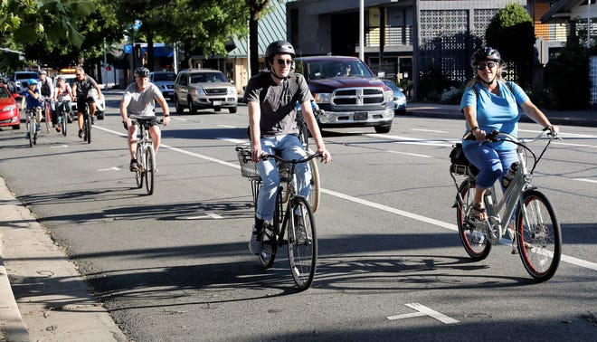 Eamon Johnston, center, a planner with the Shasta Regional Transportation Agency, rides alongside Tamy Quigley of Caltrans, right, and Redding Public Works Director Chuck Aukland, left, during the Ride with a Transportation Official on Pine Street in downtown Redding on Wednesday, May 19, 2020. Transportation planners are collecting public input for future road projects.