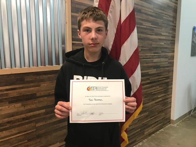 Todd Schmuhl, 13, holds his Youth Fire-setter Prevention and Intervention certificate of completion on Thursday, May 13, 2021.