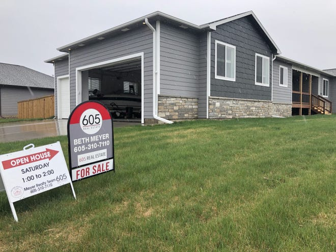 The home for sale in northern Sioux Falls was priced at $470,000 in early May. Open houses for homes in the $200,000 price range have drawn dozens of potential buyers amid a seller's market with low inventory.