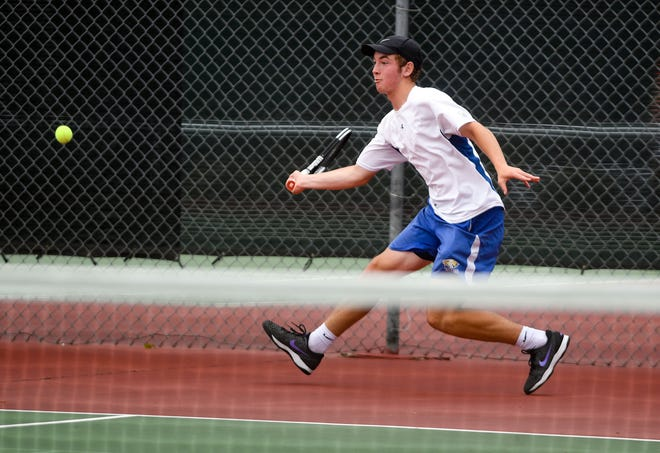 Aberdeen Central's Gabe Goetz moves to connect with the ball during the state high school tennis tournament on Thursday, May 20, 2021 at McKennan Park in Sioux Falls.