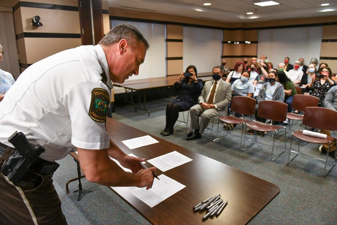 Stearns County Sheriff Steve Soyka signs a community policing agreement during a ceremony Wednesday, May 19, 2021, at the Stearns County Administration Center in St. Cloud.