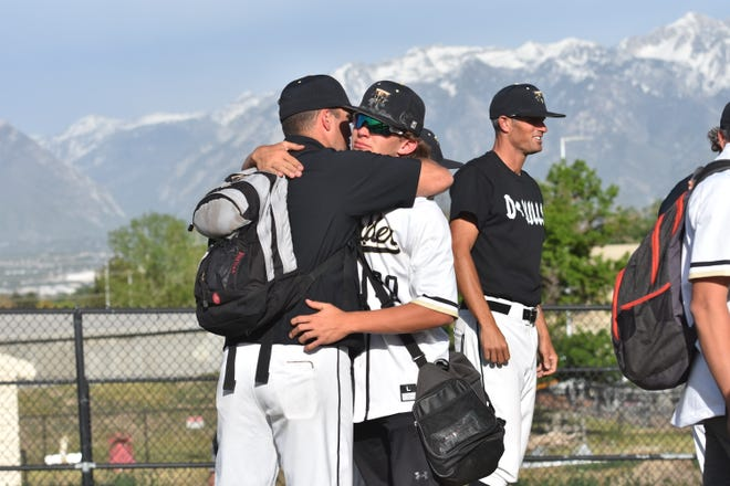 Desert Hills coaches hug their players after losing to Mountain Crest 13-0 in the 4A Tournament.