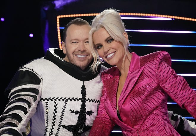 """Donnie Wahlberg, left, and wife Jenny McCarthy in Wednesday's episode of """"The Masked Singer."""""""