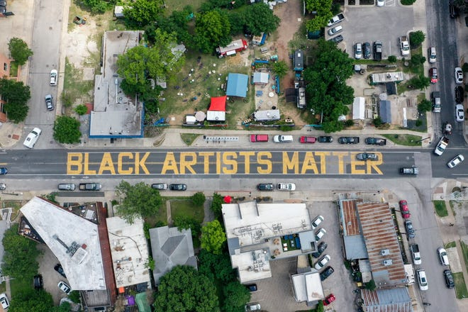 A mural can be seen on East 11th Street next to Kenny Dorham's Backyard in East Austin on May 17, 2021. The mural was painted by 50 artists and 30 volunteers last summer and was supported by DiverseArts Culture Works and other partners. [FILE]