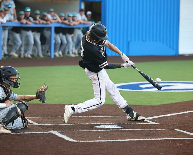 Lucas Sparschu lines a two-run double for Rouse during its 3-1 win over Cedar Park Thursday. The Rouse win moves the Raiders on to round four of the UIL 5A baseball playoffs.