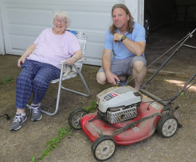 Todd Earle has been moving the lawn of his former teacher Adele Looney, 98, for 40 years in Wadsworth. They first met in Looney's home economics class at Wadsworth's middle school and are now good friends.