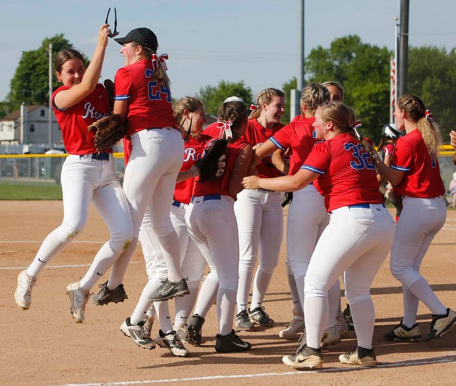 The Revere softball team reacts to defeating Norton 9-4 in a Division II district softball final at Willig Park on Thursday. [Karen Schiely/Beacon Journal]