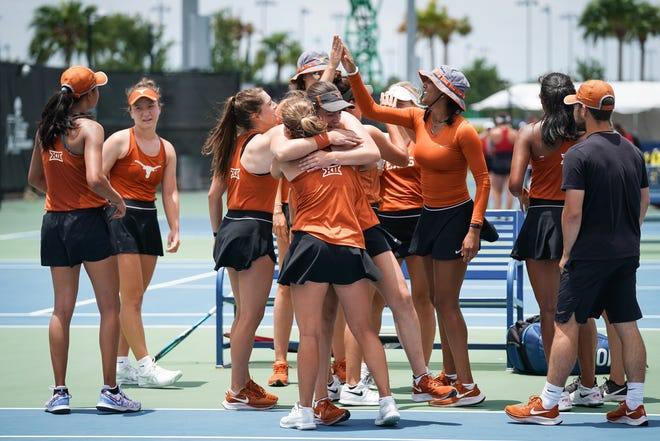 The Longhorns share congratulations after their 4-0 sweep of North Carolina State in the NCAA semifinals. Second-ranked Texas will meet either No. 1 North Carolina or No. 5 Pepperdine in Saturday's championship final.