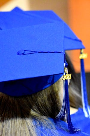 A 2021 tassel hangs from the mortarboard of a recent Ardmore Literacy Leadership organization graduate Thursday, May 20, 2021. A dozen learners were on hand to receive diplomas or certificates during a commencement ceremony at the Colvert Center.