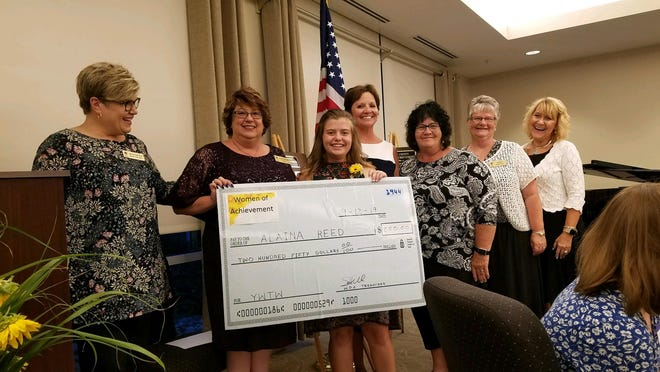The Ashland County Women of Achievement present the Kay Conrad Young Woman to Watch award to Alaina Reed in 2019.