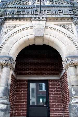 A large, looming doorway signals the entrance to the Barnesville Masonic Temple on E. Main Street.