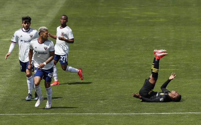 Crew winger Luis Diaz falls to the turf beside D.C. United midfielder Moses Nyeman (27), defender Tony Alfaro (93) and midfielder Russell Canouse on May 8. The Crew's three goals — two of which are own goals — are tied for lastamong all 27 MLS teams.