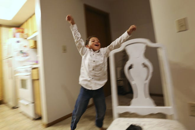Darius Boggs Jr., 6, celebrates after he won a game of Connect4 with his family in their apartment at The Vista at Rocky Fork in Gahanna on November 1, 2018. [Samantha Madar/Dispatch]