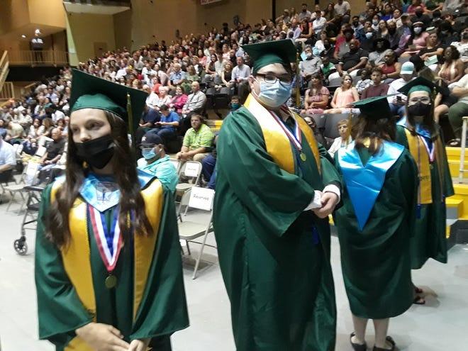 Central Lafourche High School graduates line up to receive their diplomas Thursday at the Warren J. Harang Jr. Municipal Auditorium.