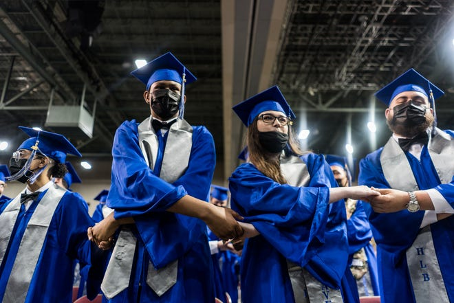 H.L. Bourgeois High School graduates sing the alma mater during Thursday night's commencement at the Houma-Terrebonne Civic Center.