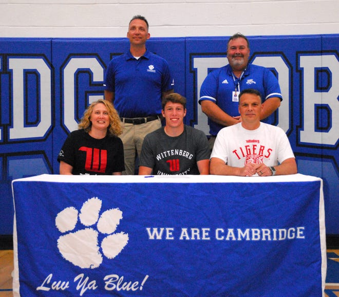 Dominic Cork, front and center, pictured with his mom, Melissa, and dad, Steve, along side him, and Cambridge High School Athletic  Director Aaron Quinn and Cambridge High School Principal Jason Bunting.