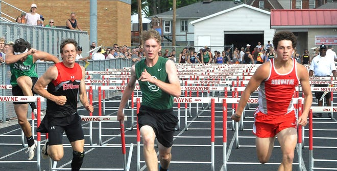 Norwayne's Nic Graham (right) just bests Smithville's Alex Taylor (middle) in the 110 hurdles.