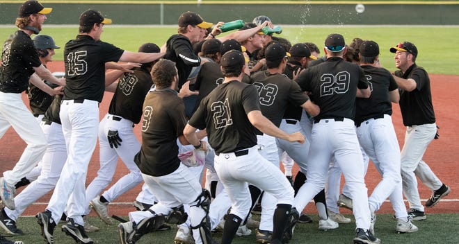 The College of Wooster celebrates after winning Game 2 of the NCAC Championship Series, keeping their conference title hopes alive.