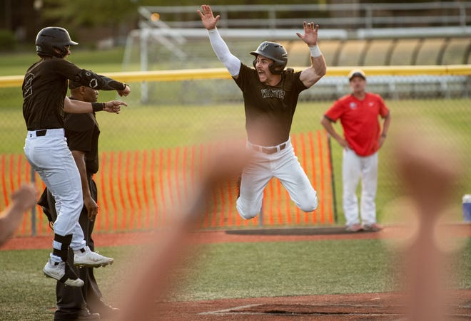 Wooster's Dominic Stilliana celebrates after scoring the game-winning run to keep Wooster alive in the NCAC Championship Series.