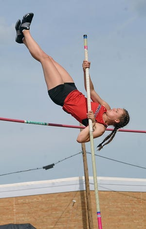 Orrville's Ainsley Hamsher clears 11 feet, 8 inches on May 21, 2021, to set a personal record in the pole vault. She broke it by four inches on May 28 while winning a regional title to qualify for this weekend's state track meet. [Mike Schenk / The Daily Record]