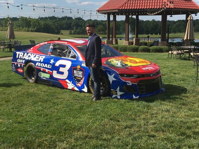 NASCAR driver Austin Dillon poses with his No. 3 car. [Ben White for The Dispatch]