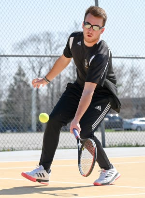 Western Wayne tennis star Lenny Maiocco attacks the net during recent Lackawanna League action. The senior southpaw has now won three consecutive District 2 Class AA singles titles.