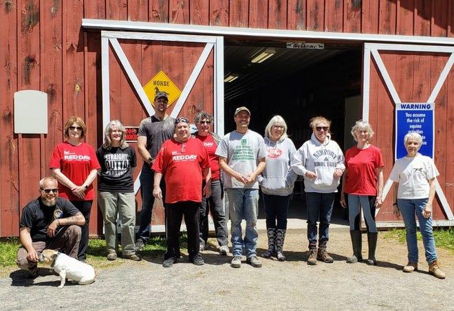 Keller Williams Real Estate volunteers with GAIT TRC staff.