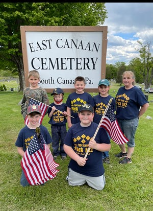 This group of Cub Scouts took the time to replace worn flags with new ones.