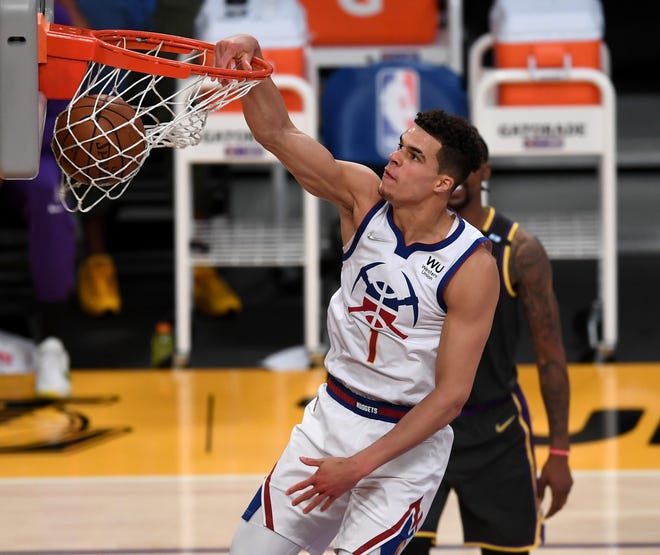 Denver Nuggets forward Michael Porter Jr. (1) dunks the ball in the second half of a game against the Los Angeles Lakers this season. Porter, the former Missouri player, is averaging 19 points and 7.3 rebounds in a breakout season as the Nuggets head into the NBA playoffs.
