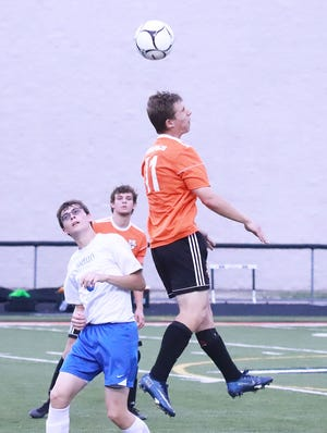 Mediapolis' Drew Zurmuehlen heads the ball in the Bulldogs Class 1A substate win over Wapello at Mediapolis Thursday evening at the Mediapolis Athletic Complex. Mediapolis won, 8-3.