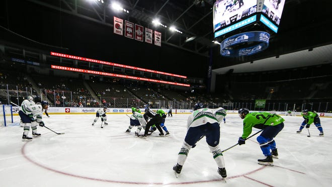 The Icemen and Everblades face off during the first period of an April game.