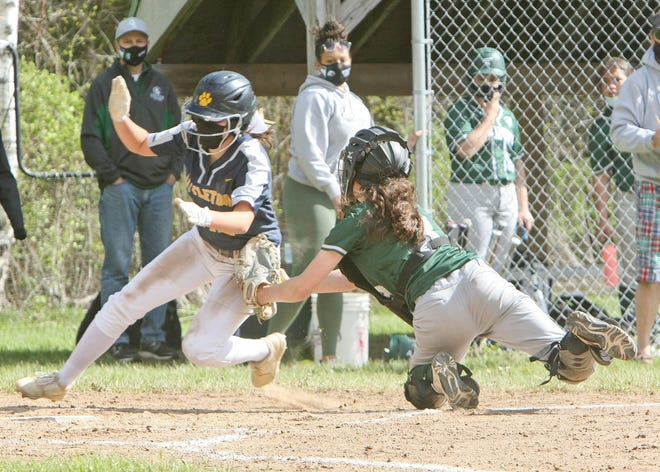 Oakmont catcher Theresa Brouillet tags out Littleton's Lindsay Barbella during their game earlier this season in Ashburnham. Brouillet is a senior captain for the Spartans this spring.