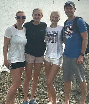 Former Gardner High track and field standout Jill (Croft) Paige, left, resides in Tewksbury with her daughters, Makayla and Cassidy and husband Mike. Paige joined the Tewksbury High track coaching staff when her daughters joined the team.