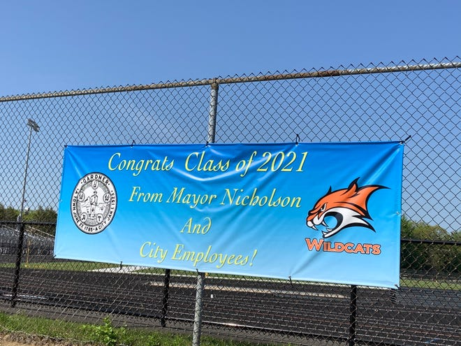 With traditional graduation ceremonies being curtailed due to public health restrictions, Mayor Michael Nicholson and the city's employees found a novel way to congratulate Gardner High School's Class of 2021.