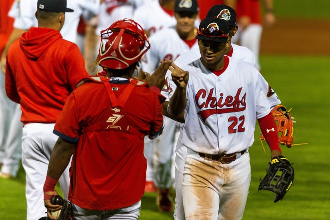 Jhon Torres high fives his teammates after Peoria's 4-3 win over Quad Cities at Dozer Park on Thursday, May 20, 2021. Torres had a hit and an RBI in the win.
