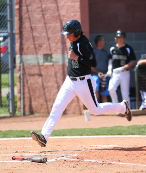 Aurora first baseman Ben Schechterman scores a run during the Greenmen's 12-8 loss to Nordonia Thursday in a Division I sectional final.
