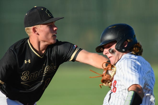 Amarillo's Bryson Slaughter tags Lubbock-Cooper's Jude Cook at third base during Thursday's Game 1 of a Region I-5A quarterfinal series. The Sandies won 9-5.