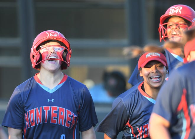 Monterey's Tatiana Trotter, left, yells in celebration after hitting a home run against Justin Northwest in Game 1 of a Region I-5A semifinal series Thursday, May 20, 2021, at Abilene Christian's Poly Wells Field in Abilene.
