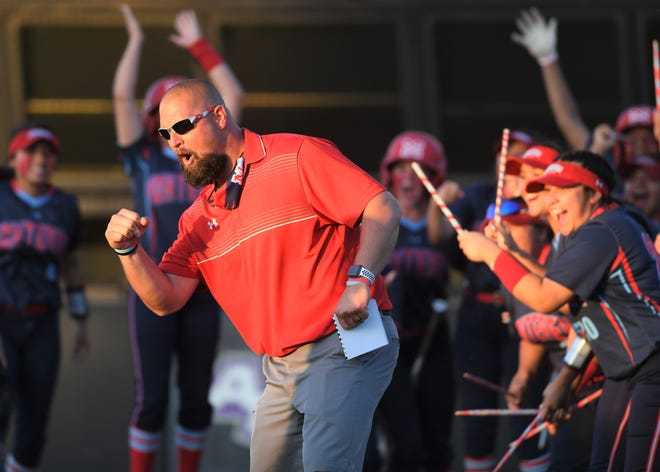 Monterey softball coach Brian Cronk celebrates after Tatiana Trotter's home run against Justin Northwest in Game 1 of a Region I-5A semifinal series Thursday, May 20, 2021, at Abilene Christian's Poly Wells Field in Abilene.
