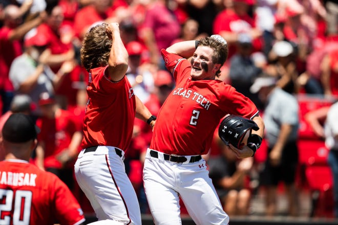 Texas Tech's Jace Jung celebrates with a teammate after hitting a two-run home run in the second inning during a Big 12 Conference game Friday, May 21, 2021, against Kansas at Dan Law Field at Rip Griffin Park.