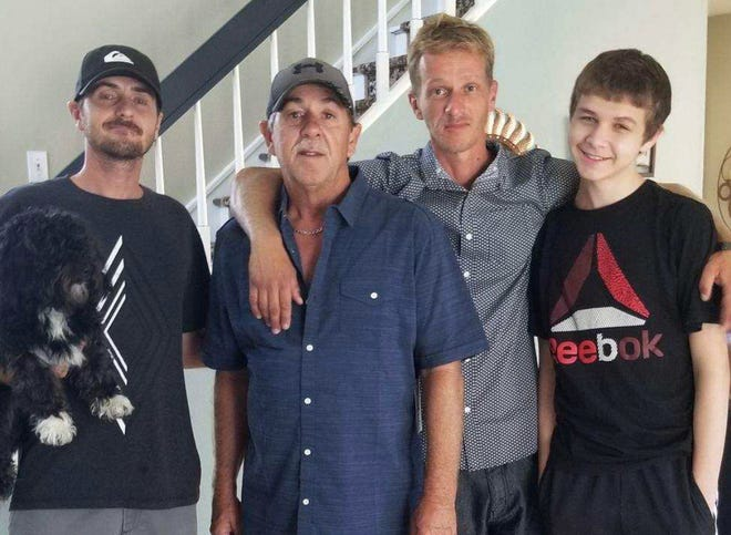 Shaun Marc Seamann, 39, second from right, in happier times with his brother Daniel Seaman, left, father Marc Seaman, and son Seth Seaman.