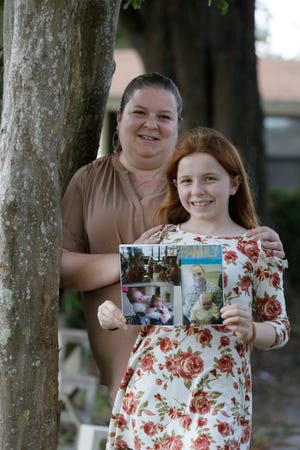 Catie Ivey shows a photo collage she made at the Bethany Center in Auburndale after the deaths of her grandfather, Michael Fahrion, and her great-grandfather, Ben Coppola, in 2019. Her mother, Cathy Carlock, said the center's grief-therapy services helped Catie cope with separation anxiety caused by the two losses.