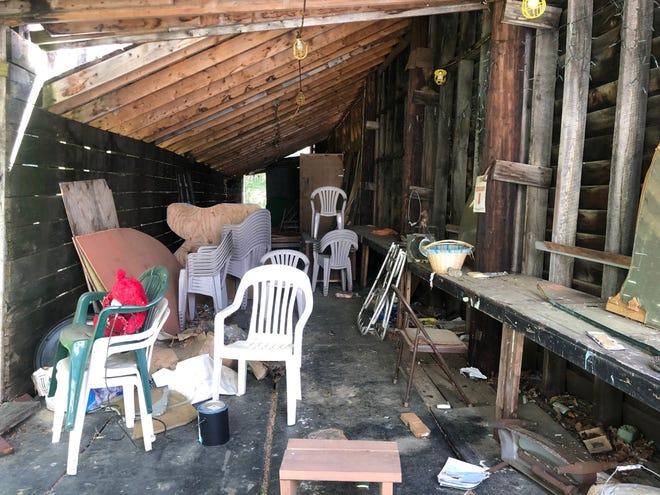 """The backstage area at the Larenim Park Amphitheater is littered with trash, chairs and prop pieces left behind after the 2017 production of """"The Wedding Singer."""""""