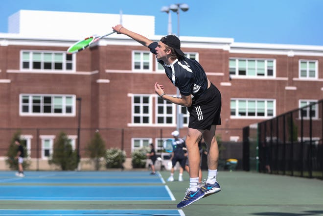 Franklin High senior Liam Marr serves in the first singles match against Oliver Ames at Franklin High School on May. 20, 2021.