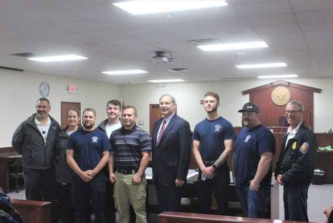 U.S. Sen. John Boozman stands with Southwest EMS workers at the Crawford County Courthouse in recognition of National EMS Week.