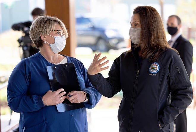 Lisa Peacock, (left) health officer with the Health Department of Northwest Michigan, is shown on a recent tour of a health department clinic in Petoskey with Gov. Gretchen Whitmer.
